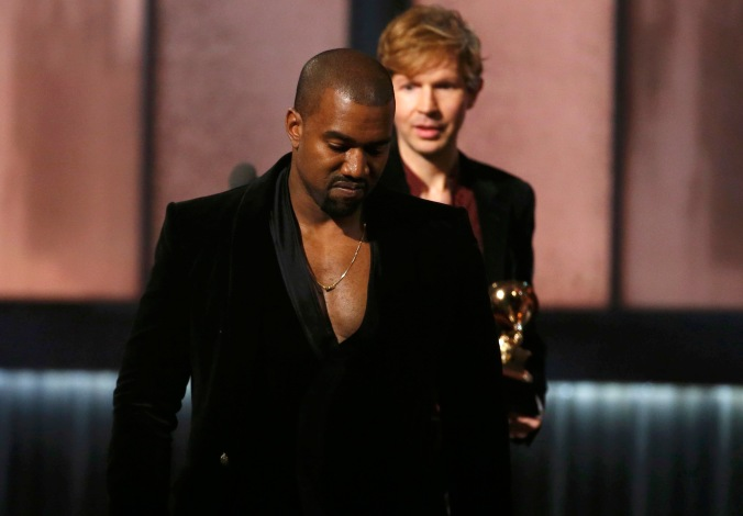 "Beck watches Kanye West after Beck won album of the year for ""Morning Phase,"" at the 57th annual Grammy Awards in Los Angeles"